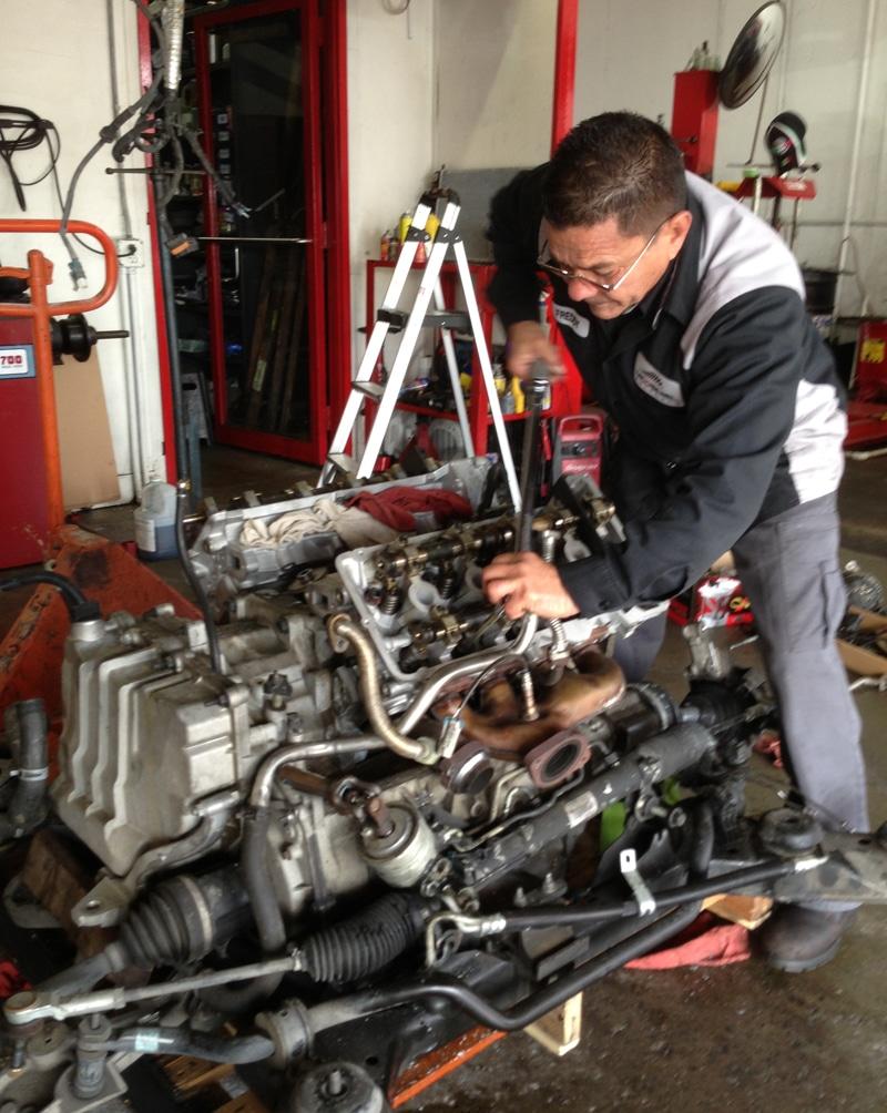 Tech working on engine
